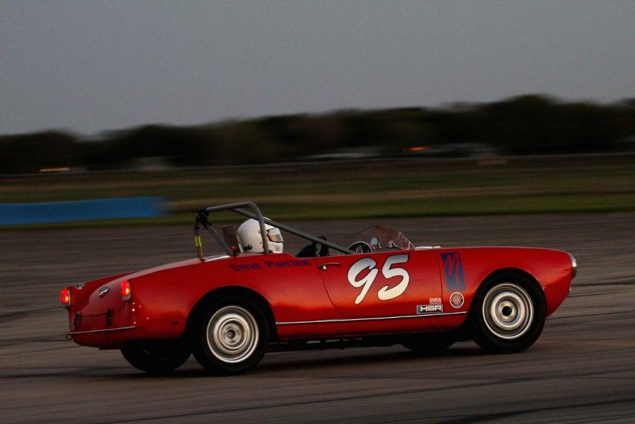 """Steven Piantieri """"rocketing"""" into turn 16 in his 1960 Alfa Romeo Giulia Spider."""