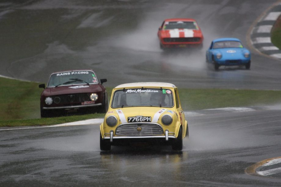 1967 Mini Cooper in turn Five. The aptly named Rains Racing Alfa Romeo GTV ran out of traction.