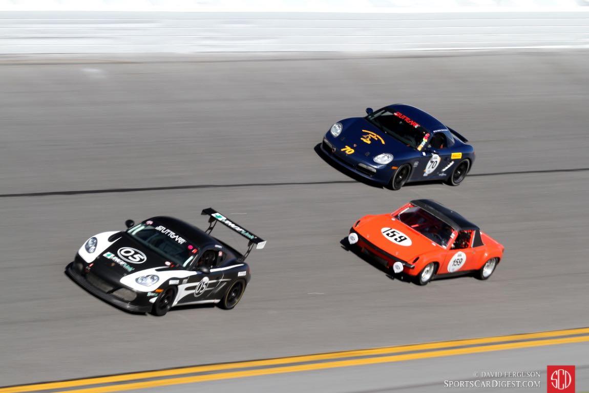 A trio of Porsches.