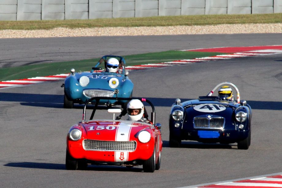 Dennis Gonzalez in his 1966 MG Midget leads Michael Silverman's MGA, and Richard Fisher's Sprite