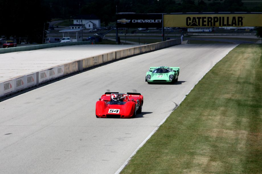 Jim Pace's 1968 McLaren M6B leads Dave Ritter in the 1968 Lola T70 MKIIIB