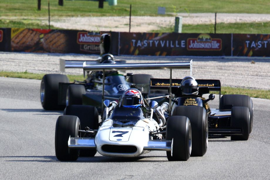 Tony Adamowicz's 69 Eagle, crooked wing and all, leads a Lotus and a March.