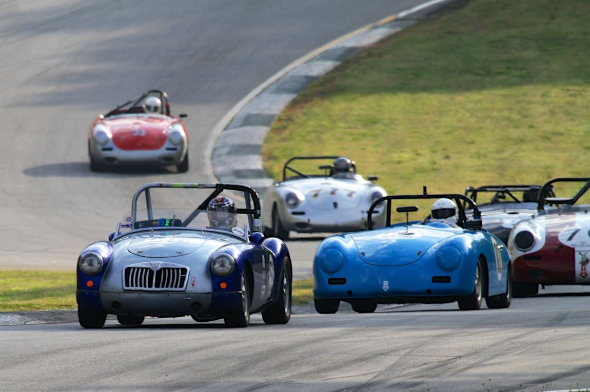 Richard Schnabel guides his 59 MGA into turn 5 ahead of a gaggle of Porsche Speedsters.