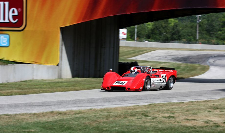 Jim Pace goes under the Johnsonville Bridge in his McLaren M6B