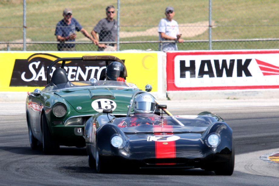 Mark Brannon in a 1963 Lotus 23B is followed by John Daniels in his oversteering 1965 Sunbeam Tiger