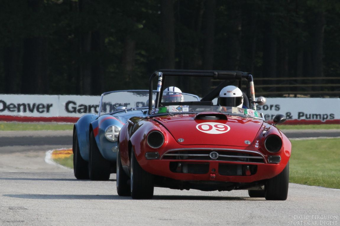 Charles Glapinski and Chris MacAllister in two of Carroll Shelby's creations, a 66 Sunbeam Tiger and a 64 AC Cobra.