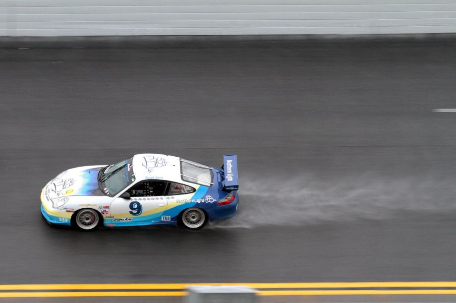 Trans Am Porsche kicking up a spray in the banking.