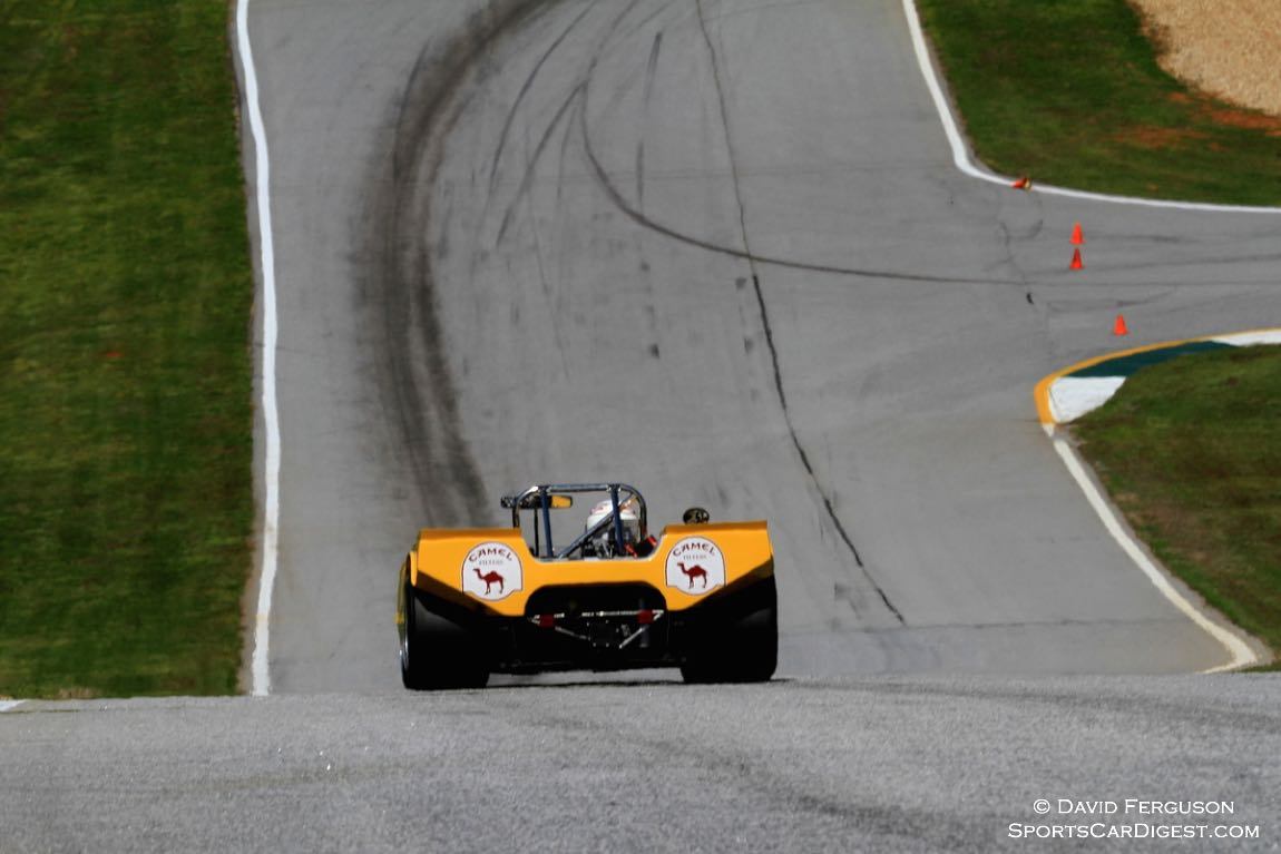 John Delane, 71 Lola T212, heading down to the daunting turn 12.