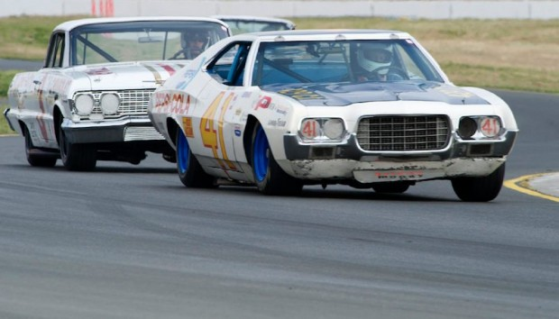 Jim Hague's 1972 Ford Gran Torino leads Jim Koehler's 1963 Chevrolet Impala