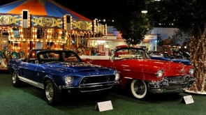 1968 Shelby Mustang GT500-KR Convertible and 1956 Cadillac Series 62 Convertible pictured in front of the 1918 Herschell-Spillman 32' Carousel