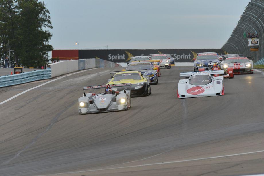 Travis Engen, Audi R8 LMP, takes Group 11 into Turn 1.