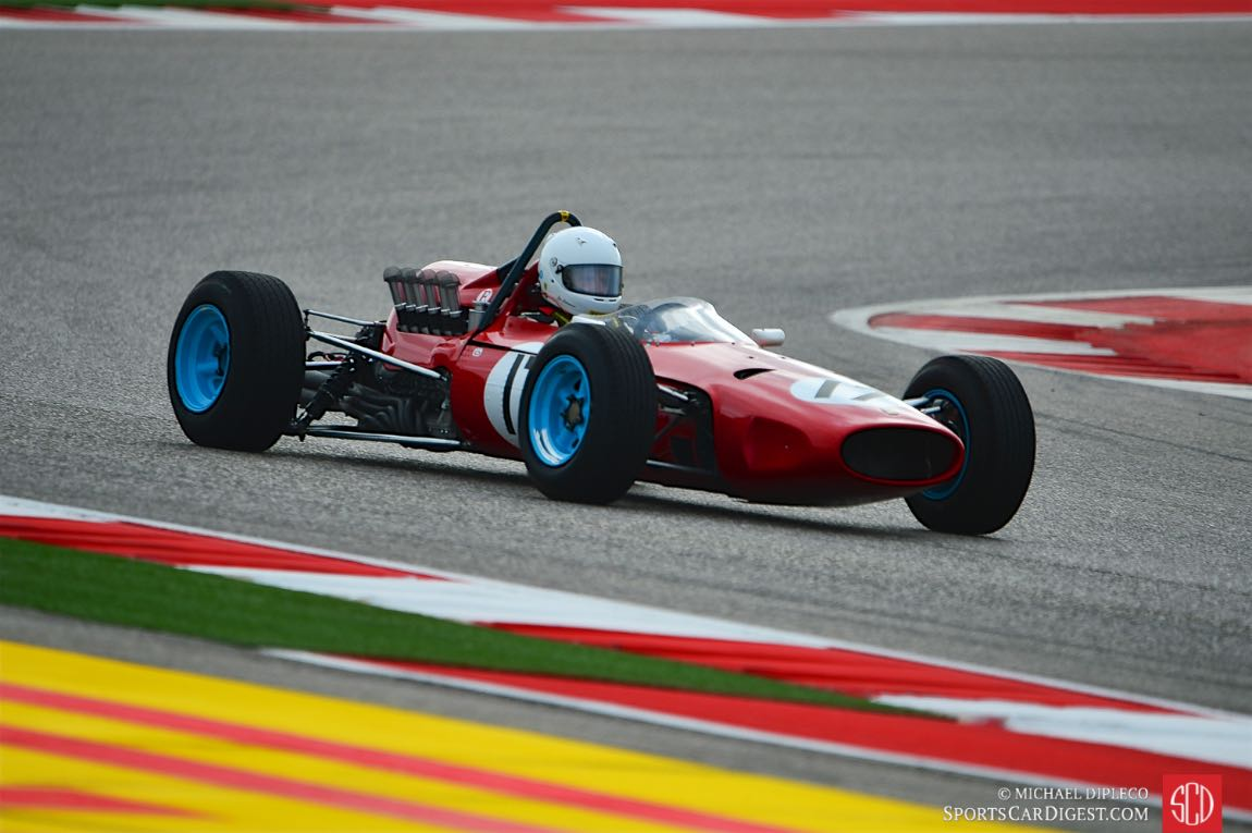 Old Formula One cars are outdoors | TexAgs