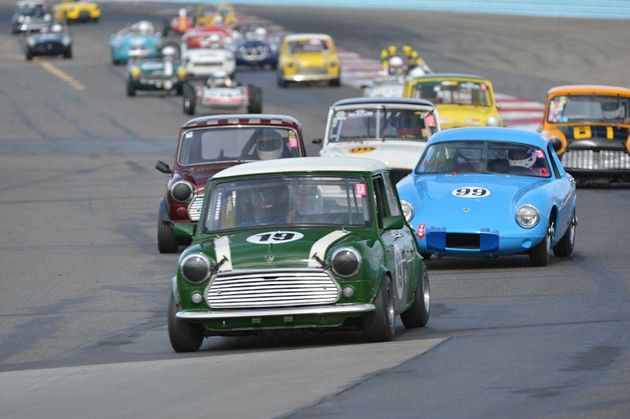Dave Morgan, 1968 Austin Mini Cooper, brings Group 1 into Turn 2.