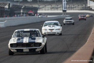 Camaro, Mustang, Camaro and Mustang head for turn one