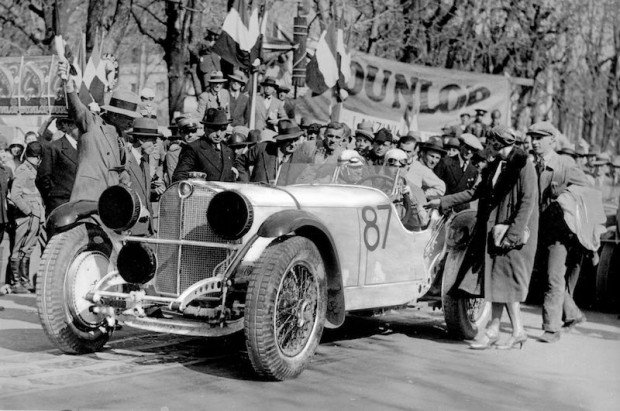 1931 Mille Miglia. His Excellence Turatti gives the starting signal for Rudolf Caracciola and his co-driver Wilhelm Sebastian in a Mercedes-Benz SSKL racing car with the starting number 87. Caracciola's wife Charly is also in the picture, to the right of the car.