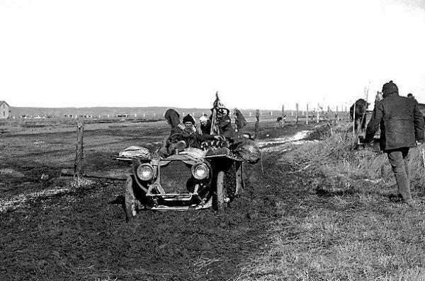The unpaved roads in the U.S. were quagmires of mud.