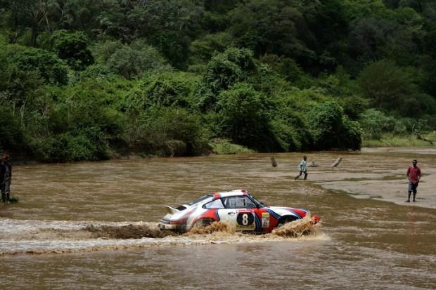 Porsche 911 of Stephen Troman makes its way across body of water