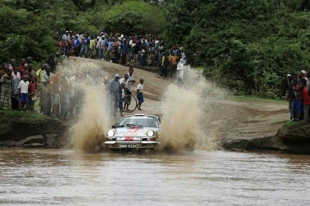 Curious onlookers watch Thomas Flohr cross water in his Porsche 911