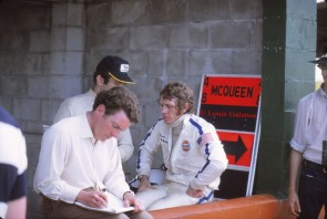 Peter Revson (cap) and Steve McQueen discuss strategy for the 1970 Sebring race.  Revson would do the lion's share of driving due to McQueen's broken foot.  By some estimates Revson would drive 8 of the 12 hours of the race.