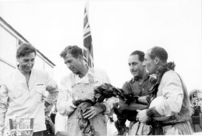 Roy Salvadori (l) with Carroll Shelby and Stirling Moss at Le Mans