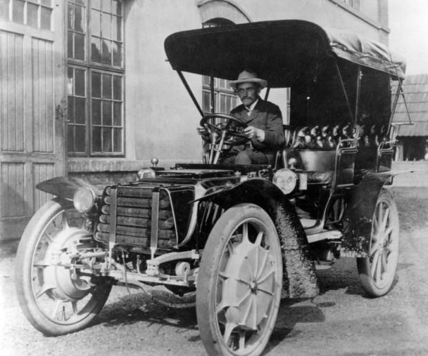 Ferdinand Porsche at the wheel of one of his 1903 Lohner-Porsche 'hybrid' touring cars.