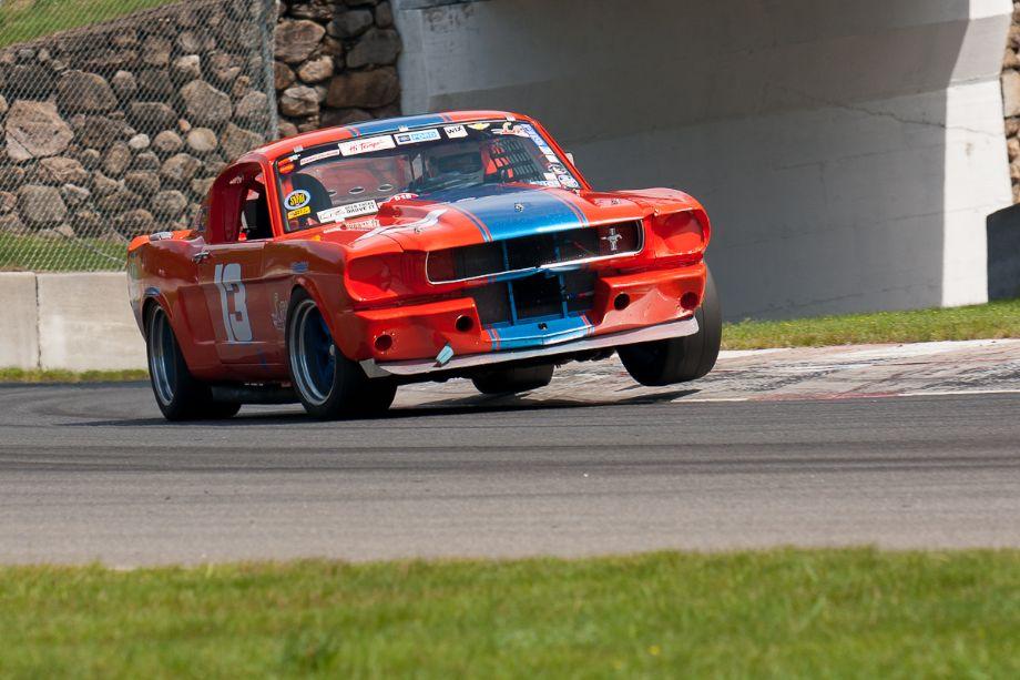 Paul Bissonnette puts a wheel up over the curb in his Ford Mustang. HMSA Sommet des Legendes 2013 (Taken at 1/500 sec.@ f/5.0 - ISO 100) © 2013 Victor Varela