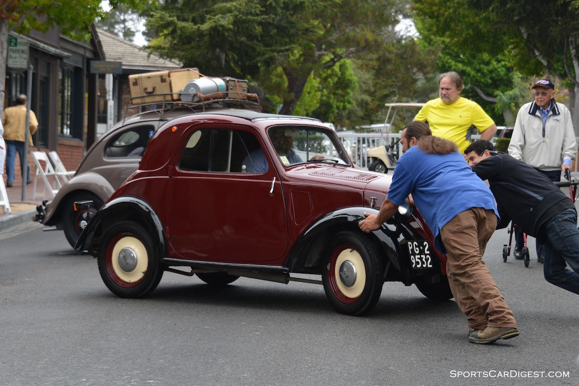 Pushing the Fiat Topolino into its spot at the Carmel Concours 2015
