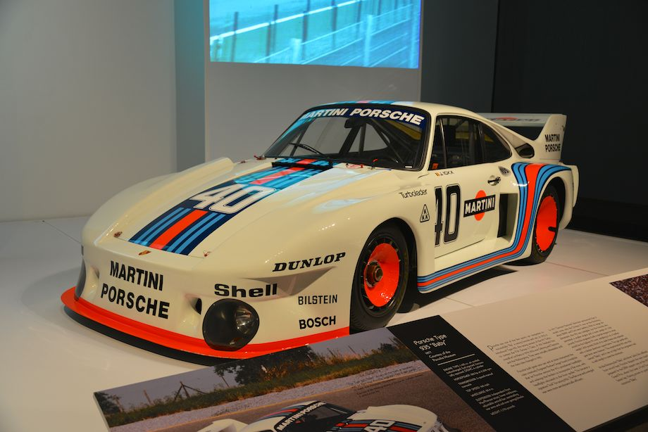 """1977 Porsche 935 """"Baby"""", Porsche Museum - In 1977 German National Television announced it would only cover the Division II race at the Norisring, where BMW and Ford were battling. With its larger displacement, the normal 935 was ineligible, but the formula also permitted a smaller engine and a lower weight of 1,700 pounds. Porsche engineers built a special engine for what would be the lightest 911 ever, weighing in at 1,650 pounds. Much of its steel chassis was replaced with a tubular aluminum space-frame. The gas pedal and gear lever were titanium. The experimental 935 was nicknamed """"Baby,"""" and it was so light that the engineers had to add weight to meet the minimum. At the Norisring, the """"Baby"""" and Jacky Ickx suffered from record heat. Porsche skipped the next round and prepared for the DRM support race at the 1977 German Grand Prix, where Ickx beat the Fords and BMWs and set the fastest lap. Having proven its point, Porsche retired the victorious """"Baby."""""""