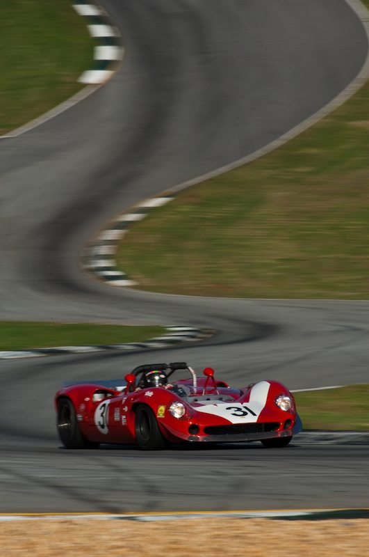 The 1965 Lola T70 Mk II of Johan Woerheide out of the Esses and through Turn Five