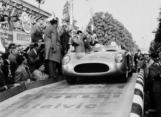 Stirling Moss starts the 1955 Mille Miglia in the Mercedes-Benz 300 SLR #722