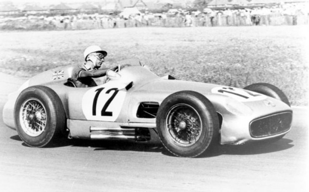 Stirling Moss drove the Mercedes-Benz W196 to victory at the 1955 British Grand Prix at Aintree.