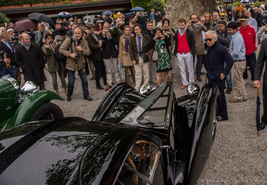 The crowd looking at Ralph Lauren, who is looking at his 1938 Bugatti T57SC Atlantic