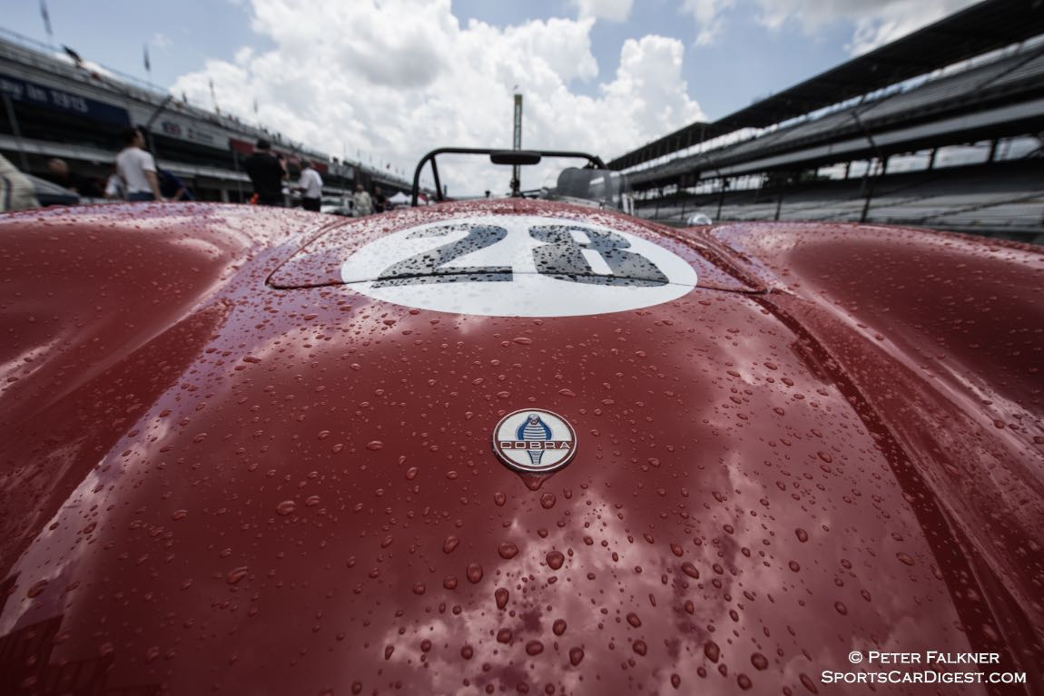John McCormick's 85 Ford Cobra IV waits for dry and its legend driver Lyn St. James