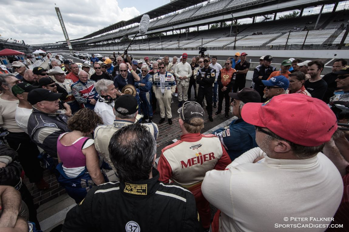 Downpour means a quick Pro-Am drivers meeting to discuss procedures