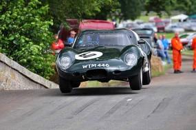 Winner Justin Law in his Lister Jaguar prototype flies to victory