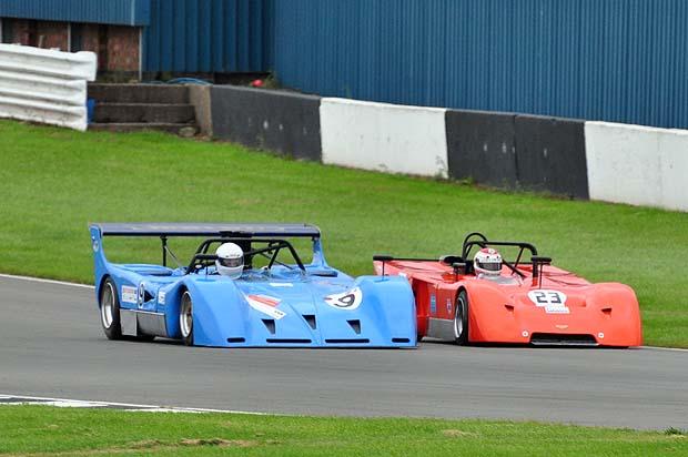 Frank Bradley's March 717 powers past Evans' 2 litre Chevron down the Dunlop straight