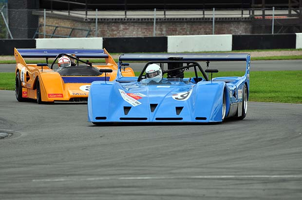 Bradley's March 717 leading Piper's McLaren M8F in the early stages of the race