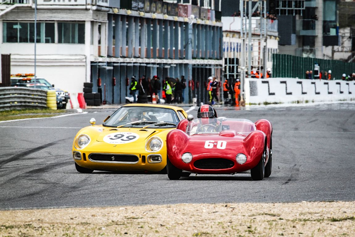 A Ferrari 250 LM attempting to sneak up on a Maserati Birdcage
