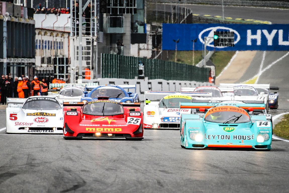 The Group C class storms down the front straight
