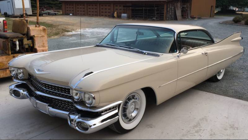 Lot # T250 1959 Cadillac Coupe de Ville 2-Dr. Hardtop; S/N FW17611; Beige/Beige leather with cloth inserts; Unrestored original, 3+ condition; Hammered Sold at $45,000 plus commission of 10.00%; Final Price $49,500. With Reserve. – 390/325hp, automatic, power brakes, power steering, power seat, pushbutton radio, dash clock, Autronic Eye. – Original paint has polish swirl, scratches and a rub through near the driver's mirror. Major rubs at the front of the door opening in the jamb. Chrome is slightly aged and has scratches. Stainless bits are slightly oxidized. Interior is faded and aged lightly. Dash is wrinkled and there are stains on the lower painted portion. Original underneath. Totally unrestored and showing 61,942 believable miles. Not immaculately preserved but presentable, with an odd chassis number. – This is moderate money for a huge car in remarkably well preserved, decent, condition. A stunning weekend driver, Porsche Speedsters pale beside this behemoth which brought a superior price for its preservation.