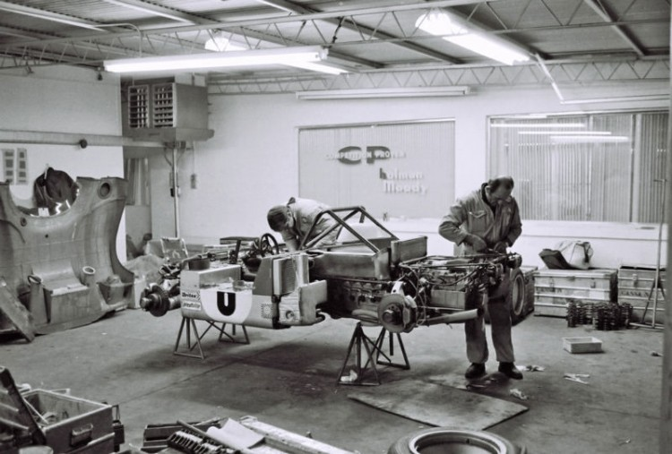 The #6 Ferrari 312PB of Tim Schenken and Ronnie Peterson being worked on by Ferrari mechanics prior to the race.  They finished 2nd in the 1972 Daytona 6-Hour Continental.