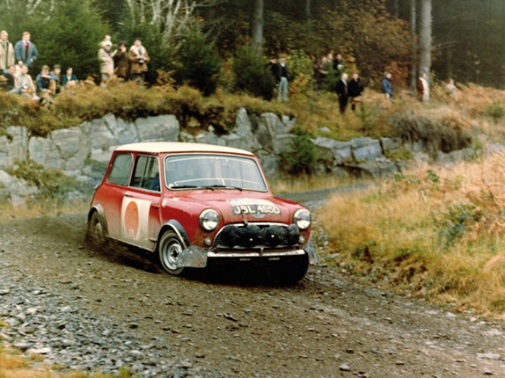 Mini Cooper racing and sliding through turn at Rallye Monte Carlo