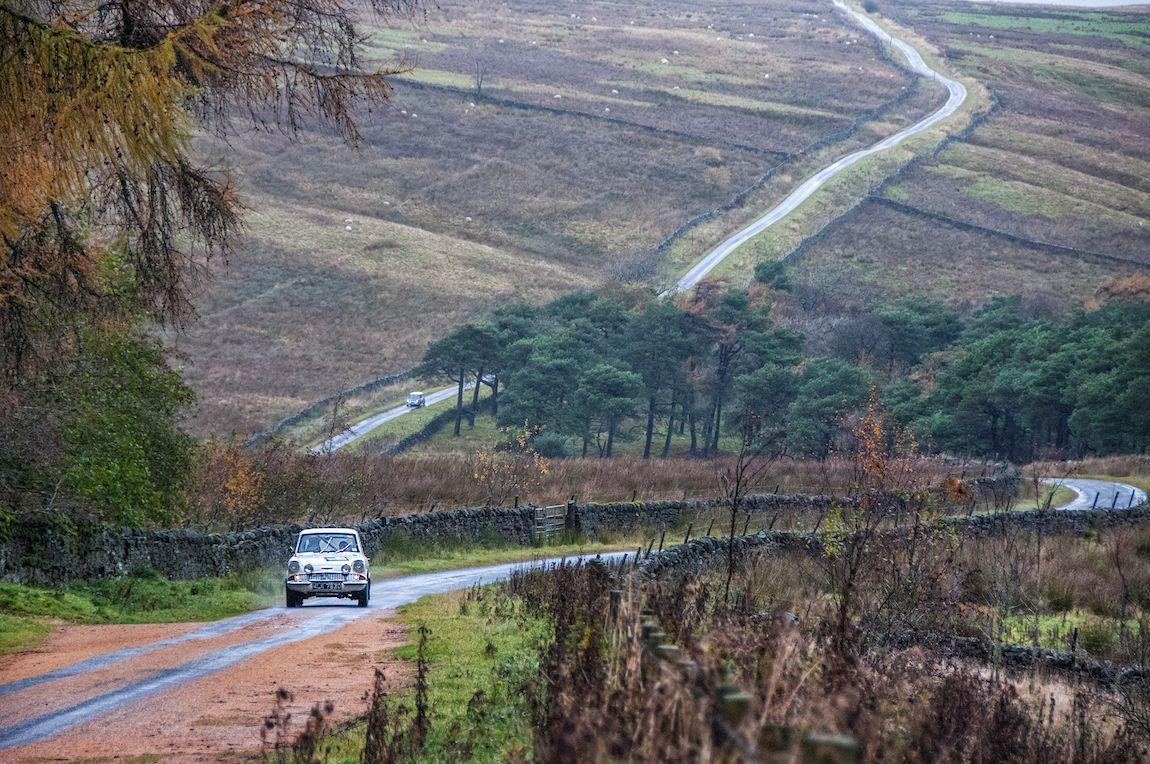 The 1966 Ford Anglia 105E and 1966 Austin Mini Cooper S wind through the amazing landscape