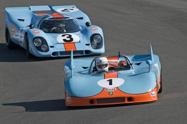 Class winning 1971 Porsche 908/3 of Brian Redman leads Bruce Canepa 1969 Porsche 917K through the Corkscrew