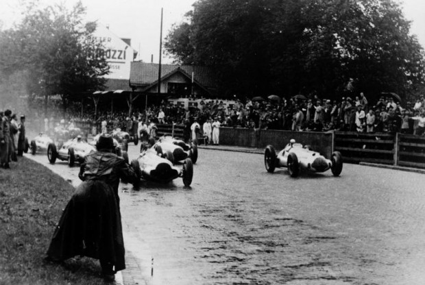 Swiss Grand Prix near Bern, August 21, 1938. The Mercedes-Benz W 154 racing cars took the lead immediately after the start in heavy rain and drove towards a triple victory. The winner was Rudolf Caracciola (on the right) followed by Richard B. Seaman and Manfred von Brauchitsch.