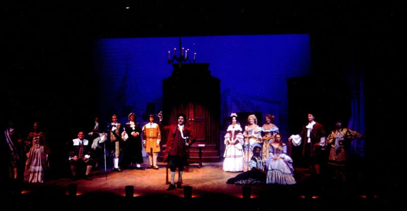 Ken Canfield's set design included a raked stage for this production. Together, we also included footlights. Each footlight had two colored bulbs in it, allowing a range of warm or cool light.