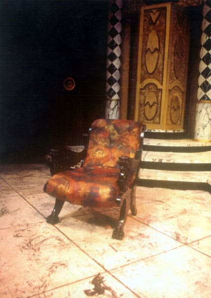 A chair, and behind it, the revolving clam-shell door which was the main entrance to the dwelling.