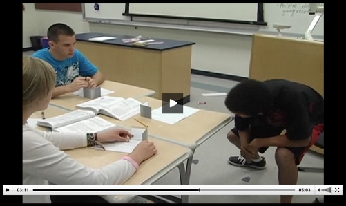 """Students investigate the shapes they """"see"""" as they change the opening angle of the hinged mirrors."""