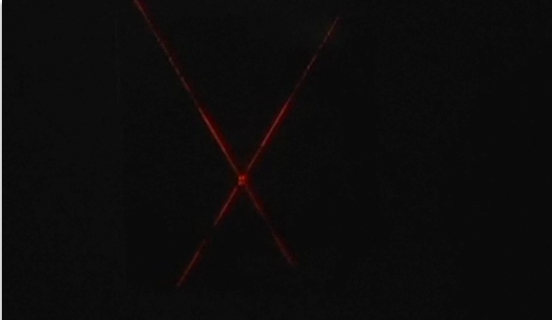 The laser and chalk dust show the reflection of the laser beam.