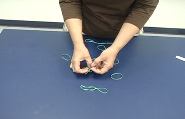 Knot two rubber bands: